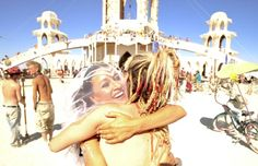 April Matulich and Crystal Rios celebrate after getting married at the 2011 Burning Man Festival.