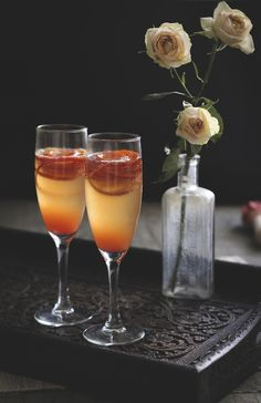 Blood Orange French 75: gin, blood orange juice, simple syrup, champage, and blood orange zest!