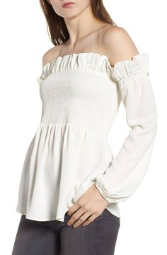 Delicate smocking along the bodice, as well as pretty ruffles, adds just-right frill to a flattering top that's ideal for everyday wear.
