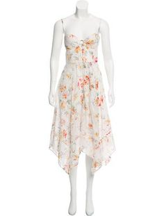 Ivory and multicolor Zimmermann sleeveless broderie anglaise midi dress with floral print throughout, structured bust, high-low hem and concealed zip closure at center back. Designer size 1.
