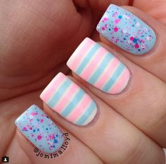 Striped nails are so cute for Summer.