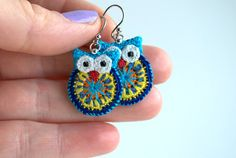 Crochet owl earrings made from embroidery thread and little black beads for eyes. They are very lightweight and easy to wear. The owls measure