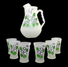 Vintage frosted glass juice set from Hazel Atlas The set includes the pitcher and 5 juice glasses Frosted glass with hand painted designs of purple and white violets with green leaves the pitcher is 7 1/2 tall and the juice glasses are4 tall with a 2 1/2 diameter Excellent vintage condition. Truly pristine with no signs of use or wear. Please see photos for close-ups and details. Using the Zoom feature will give an even closer view.  For more vintage juice glasses... http:/&#x...
