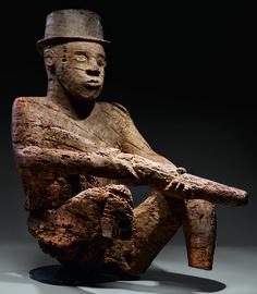 mbembe homme assis avec fusil comll privée.jpg-01.jpg (2560×2936)