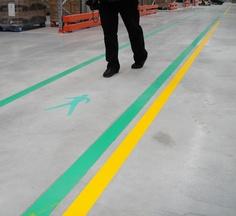 OSHA compliant Superior Mark aisle marking tape to mark pedestrian pathways.