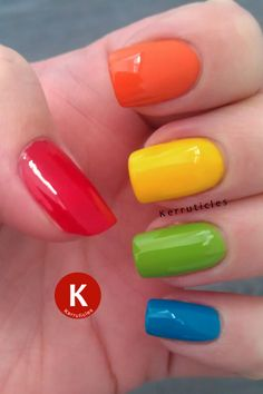 Skittle manicure in red (Bary M Blood Orange), orange (L'Oreal Lush Tangerine), yellow (George Buttercup Shine), green (Ciaté Mojito) and blue (Nails Inc Kensington Park Road)