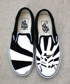 These one-of-a-kind hand-painted Vans Slip ons Feature a black and white storm trooper on one shoe and the rising sun behind him. The back of the shoes say STORMTROOPER ITZAJADET. This image is made-t
