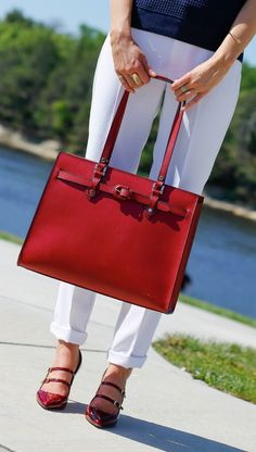 red tote bag + red maryjane pumps + white silk cuffed pants + navy mesh sweater