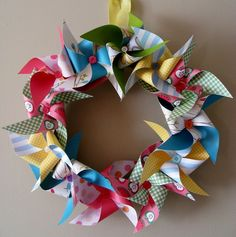 Pinwheel Wreath. Make fabric pinwheels and put on wreaths, I love it.