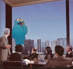 cookie monster giving an important presentation.