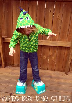 Dinosaur Activities for Preschoolers - DIY Dinosaur Feet Stilts - This easy dinosaur craft uses empty wipes containers for roaring, stomping dino fun!