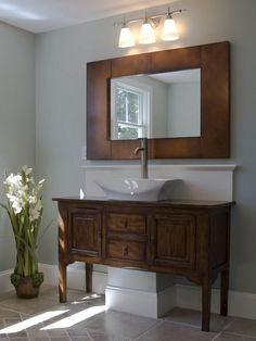 8 Great Vanities From Rate My Space: If you like this style vanity, look for antique or reproduction dining room furniture, and then find a mirror that mimics the size, style and shape of the cabinet. Buy a vessel sink and invest in a great faucet and light fixture. Paint the room a color that contrasts with the furniture, and keep the area clutter free. Design by Rate My Space contributor mmack3090_4620920. From DIYnetwork.com