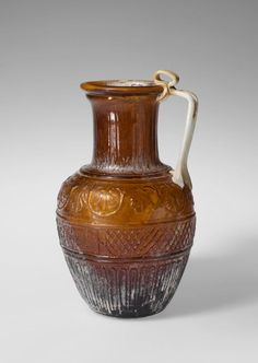 Glass jug. Period: Early Imperial, Julio-Claudian. Date: 1st half of 1st century A.D. Culture: Roman. Medium: Glass; blown in a four-part mold.