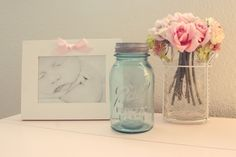Mason jars for storage; cotton balls, Q-tips, pacifiers. Larger candy jars for bibs, burp cloths, diapers.