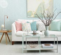 "Serene Scandi—""I gravitate to light, airy rooms – that's just what I like,"" says senior style editor Ann Marie Favot. Inspired by a fresh pastel palette, she had her coffee table bases painted mint and grey, leaving the tempered glass tops intact. From there, Ann Marie settled on Farrow & Ball's Yukutori wallpaper for subtle colour and texture in the room. Copper-toned accents and a pretty mix of toss cushions finish off the space. ""It's my version of Scandi style,"" she says. ""Simple yet…"
