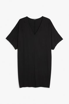This oversized V-neck T-shirt dress is the kind of dress we'll be lounging in…