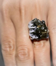 Striking black rough with a hue of olive green, accented with micro pave diamonds -extraordinary luxury ring by Diamond in the Rough!     #luxuryjewelry #black #art