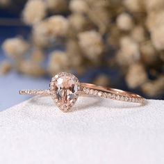 Hey, I found this really awesome Etsy listing at https://www.etsy.com/listing/533129241/pear-shaped-morganite-engagement-ring