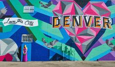 Chic color blocking: purple maxi dress and green clutch. Denver street art mural