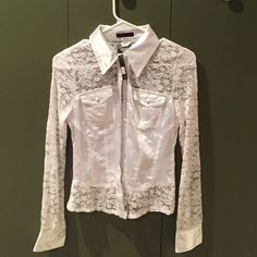 White lace button down blouse NWT White lace button down blouse. Beautiful detail down sleeves, bottom trim and top. Price tag removed because it was a gift but other tag remains. Pics don't do it justice! Tops Blouses