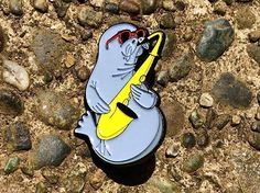 Repost @whoa.pins  Sax on the beach. Get your Saxophone Seal pins at WhoaPins.com !!!    (Posted by https://bbllowwnn.com/) Tap the photo for purchase info.  Follow @bbllowwnn on Instagram for the best pins & patches!