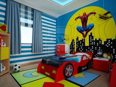 boy's batman superhero themed room with bat signal over the city