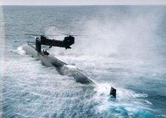 heli over submarine MH47D operates over USS Ohio class submarine..