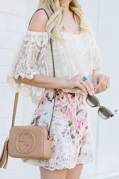 Pretty summer outfit - white lace off shoulder top, floral print shorts and beige Gucci crossbody bag