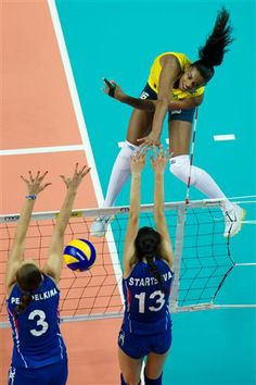 Brazil´s Fernanda Rodrigues spiking through the Russian double block