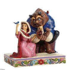 Jim Shore Belle and Beast Something There Winter Figurine   This endearing winter themed piece from Disney's Beauty and the Beast is inspired by a moment from the film when Belle and the beast discover in their hearts there is something there that wasn't there before.     6.25in H x 4.75in W x 6in L $70.00
