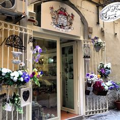 pretty storefront  Gates & shutters to flank doors
