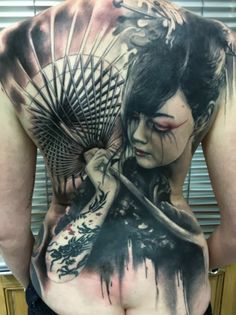 Beautiful full back tattoo by Florian Karg