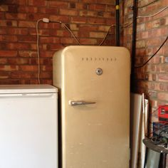 Wow! This 60 year old antique fridge is in full working order, It has an ice box that will freeze small items like a bag of peas and ice cubes. The door handle and hinges on this thing look like they have come off a 1980's Ford Cortina.  People say fashion goes in circles, Well this brilliant old fridge was definitely at the start of that circle.