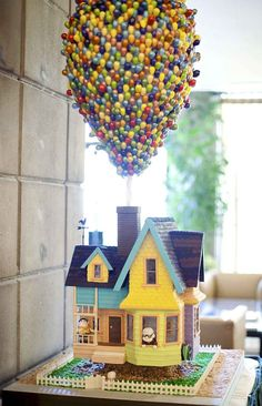 Up birthday cake! o.0 OMG OMG OMG OMG- I bet they use a helium ballon andglued m's,skittles or gumballs with royal icing sooo cool!!!