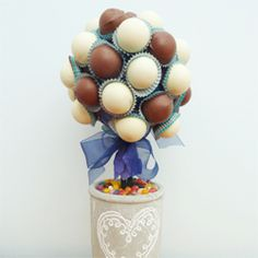 Create a striking centerpiece for a birthday party out of cake pops and some floristry foam.  It tastes pretty good too! All You Need Is, Cake Pop Centerpiece, Centerpieces, Mini Cupcakes, Cupcake Cakes, Cup Cakes, Cow Appreciation Day, Cake Pop Bouquet, Cake Pop Maker