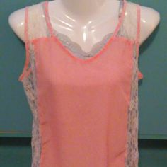 Feminine hi lo tank w/lace sides Feminine hi lo tank w/lace insert. 100% polyester and lace 100% nylon. Salmon/peach in color. Very pretty. Will include the Grey tank underneath in great shape size xs0-2 for additional $3 just specify and I will list for u Ali & Kris Tops Tank Tops