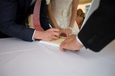 © We Do Weddings by A&J All rights reserved The bride and groom sign the register. © We Do Weddings by A&J All rights reserved Beautiful shot by our official photographer Matteo.
