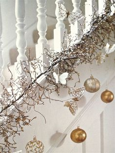 Winter white, silver, and gold with ornaments and butterflies.