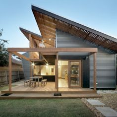 The Nest Renovated Melbourne bungalow in Brunswick West, considers efficiency and sustainability, as well as neighbouring aspect. Exterior House Siding, Exterior Cladding, Exterior House Colors, Facade Architecture, Sustainable Architecture, Contemporary Architecture, Modern Exterior, Exterior Design, Bungalow House Plans