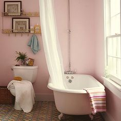Pretty pink walls give any bathroom a serene feel -- but huge windows, a potted plant and freestanding clawfooted vintage bathtub make this one especially charming. Find your perfect pink paint color here on our Style Guide! Patterned Floor Tiles, Pink Paint Colors, Perfect Paint Color, Tub Paint, Room Colors, Pink Bathroom, Pink Walls, Beautiful Bathrooms, Pink Tub