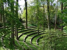 Designed by Philadelphia landscape architect Thomas Sears and completed in 1942, this naturalistic open-air theater was built on the west side of the Swarthmore College campus. Screened by holly, oriental spruce, and red cedars, the 220-foot long amphitheater is edged by a low stone wall edged with mature rhododendrons.