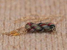 Skein of Yarn Necklace, I know it is not crochet but you could crochet something with it!