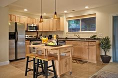 If your home doesn't have a kitchen island, consider rolling one in for extra workspace and storage. Since it's portable, you'll have the option to move it when necessary or tuck it away when you need the floor space.
