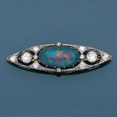 A black opal and diamond brooch, - Schmuck South Indian Jewellery, Indian Jewelry, Black Opal Jewelry, Diamond Brooch, Art Deco Diamond, Water Gems, Antique Jewelry, Vintage Jewelry, Art Nouveau Jewelry