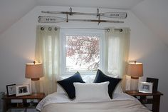 An alternative to a headboard for a bed placed under a window: antique oars. @rrrush