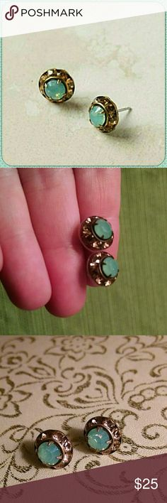 "🆕Anthropologie✨Palacios Posts Beautiful and classic. These were sold several years ago and I scooped up a safety pair. Lightweight, lovely, and they polish nicely! Unworn and recently buffed and sanitized. A delightful seafoam green encircled by smoky topaz crystals. Flawless!   ""A glimmering gem offers bright possibilities within a ring of similarly shimmering stones.""  By Liz Palacious 14k gold fill, Swarovski crystal 0.25"" diameter USA  Price pretty firm🎁  Ships next day!💌…"