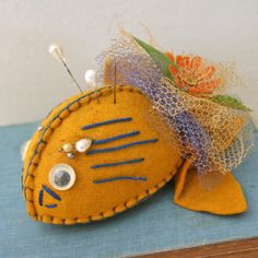 vintage 70s Silly Little Fish Felt Pincushion. $10.00, via Etsy.