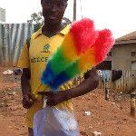 LOVE this #Ugandan guy I just met roadside, selling colorful feather dusters & wearing @Socceroos jersey! #Aussie