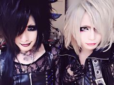 Vexent's vocalist, and his two different looks. :) I like both, but I am more partial to the color black sooo...