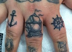 I love these! Nautical finger tattoos